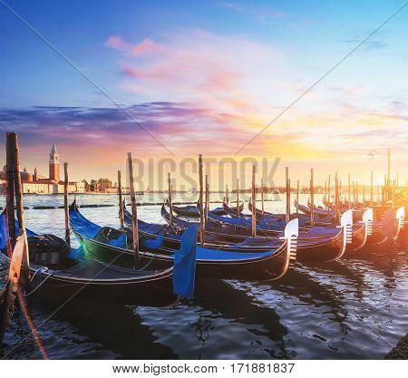 City landscape. Fantastic views of the gondola at sunset, mood on San Marco square with San Giorgio di Maggiore church in the background - Venice, Italy, Europa