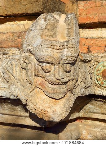 Stone face on wall - traditional sculpture in Bagan, Myanmar (Burma)