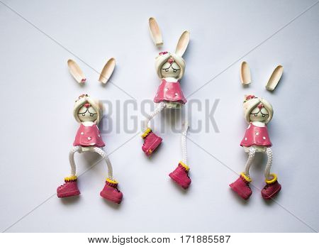 Broken toys on white background. Flat image of broken rabbit with closed eyes. Ceramic figurine broken. Concept for broken child childhood trauma pedophilia frightened kid. Bunny girl in pink dress