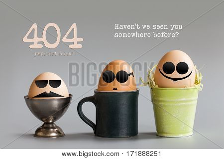 Error 404 page not found concept. Funny egg characters with black eye glasses sitting in cup bucket. Gray paper background text quote Haven't we seen you somewhere before.
