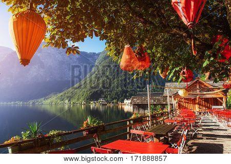 Summer cafe on the beautiful lake between mountains. Alps. Hallstatt. Austria