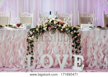 luxurious decorated table in the main hall wedding.