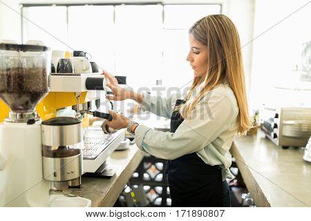 Barista Using Coffee Machine In A Cafe