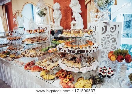 sweet buffet table. luxury decorated tables in the wedding hall