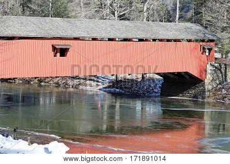 An old covered bridge stretches across this creek.