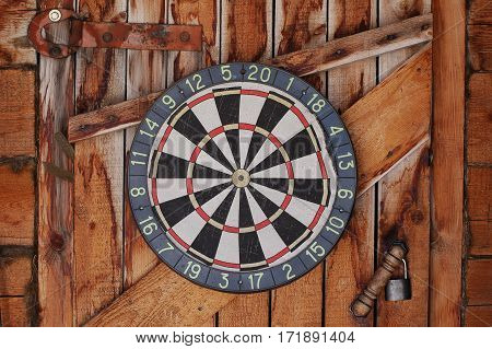 The old darts on a wooden wall