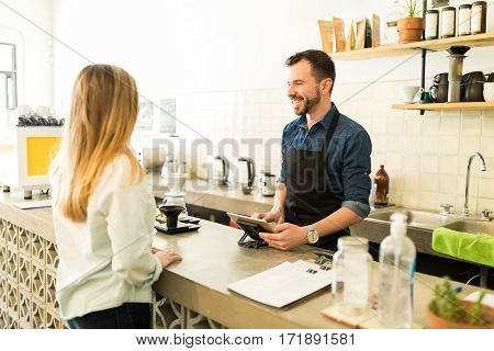 Barista Taking Order With A Tablet