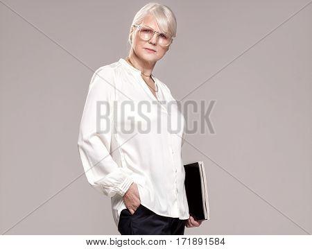 Elegant Senior Woman In Studio.