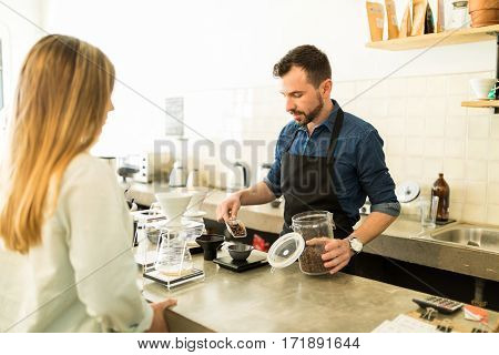Barista Weighing Coffee Grains In A Cafe