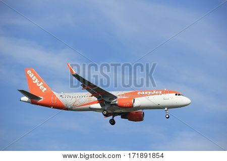 Amsterdam the Netherlands - July 21st 2016:G-EZOX easyJet 20th birthday Airbus A320 approaching Polderbaan runway at Schiphol Amsterdam Airport arriving from Manchester United Kingdom