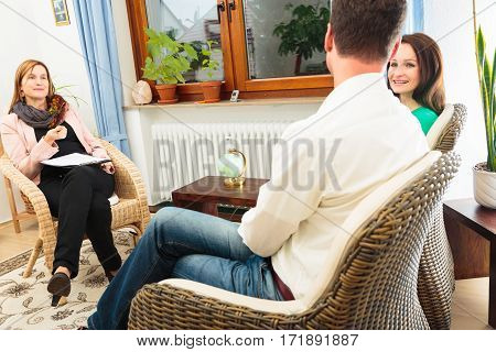 Adult couple talking to a psycho therapist