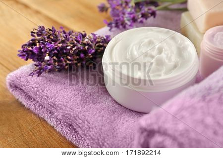 Set of spa herbal treatments on wooden table, closeup