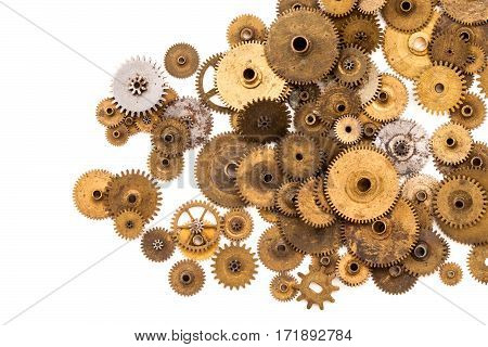 Cogs gears wheels steampunk elements on white background. Vintage clockwork parts closeup. Abstract shape object with many textured aged clockwork details
