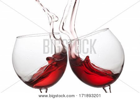 Two red wine glasses on white background. Romantic still life concept. Macro view shallow depth field photo