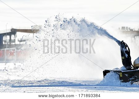 Industrial snow removal machine in action after snowfall