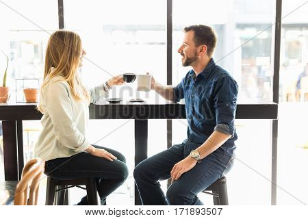 Couple Making A Toast With Coffee