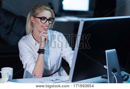 Working on the project. Involved charismatic skilled staff member sitting in the office and using modern devices while working on the project