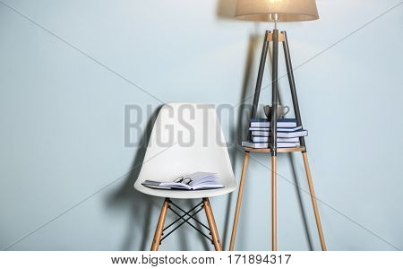 Opened book with glasses on white chair in the room
