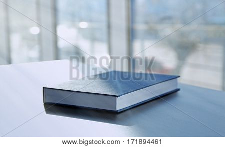 Book in hard cover on table