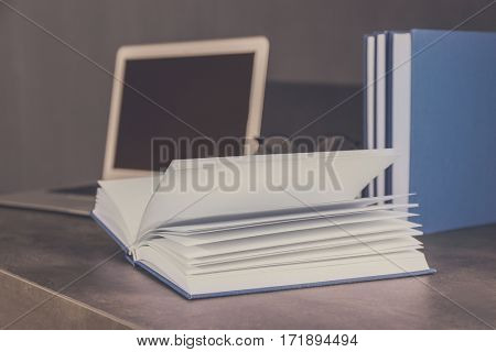 Opened book on office table