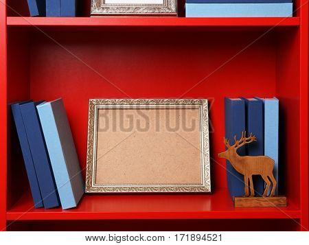 Set of books in row on white wooden shelving