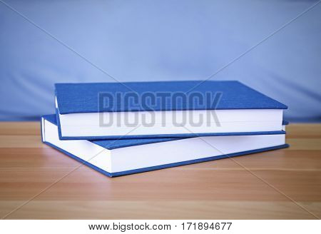 Closeup of books on wooden table