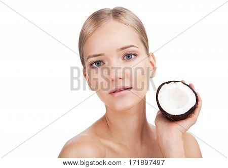 Beauty Woman face Portrait with coconut. Beautiful Blonde Spa model Girl with Perfect Fresh Clean Skin. Skin Care Concept Isolated on a white background