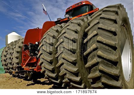 Six huge tires with deep tread on a new modern tractor