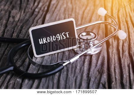 Stethoscope On Wood With Urologist Word As Medical Concept.
