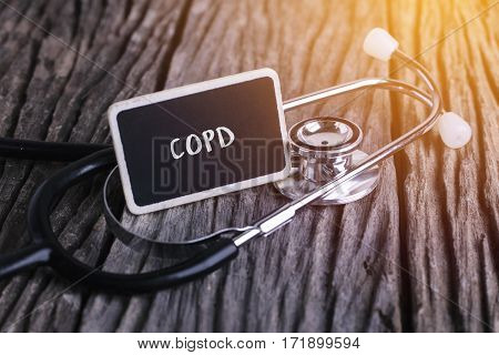 Stethoscope On Wood With Copd Word As Medical Concept.