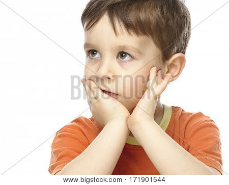 Portrait of a cute little boy sitting at table supporting his head with hand, isolated over white