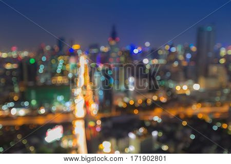 Aerial view blurred bokeh lights city road intersection skyline night view abstract background