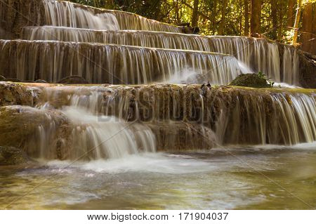 Beautiful deep forest waterfall in natural park of Thailand