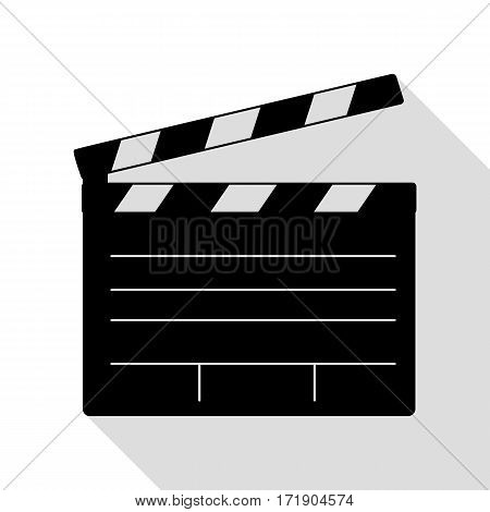 Film clap board cinema sign. Black icon with flat style shadow path.