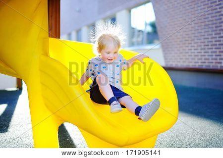 Toddler Boy Having Fun On Playground