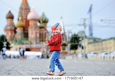 Toddler Boy Running With Russian Flag