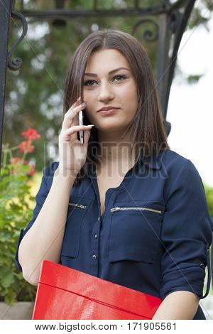 Young woman phoning with a mobile phone Selective focus and small depth of field