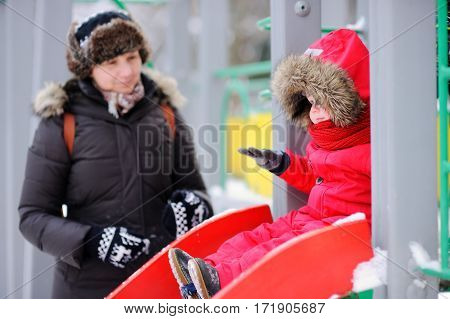 Woman And Her Little Grandson At The Playground