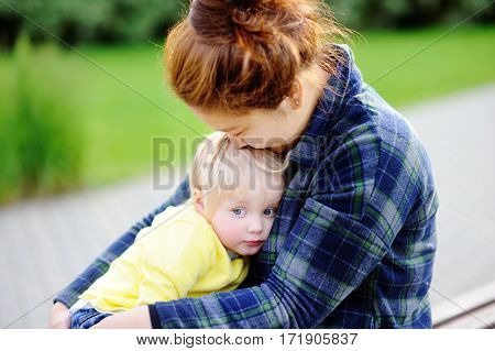Young Asian Woman With Cute Caucasian Toddler Boy
