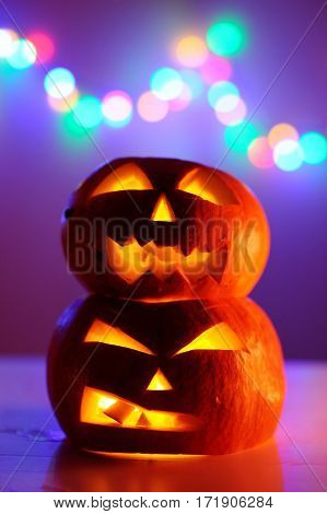 Two Halloween Pumpkins Head Jack Lantern With Colorful Lights On Background