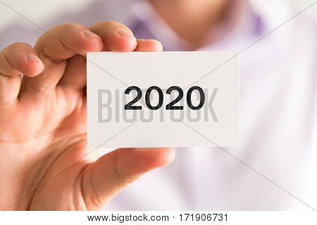 Businessman Holding A Card With Text Year 2020