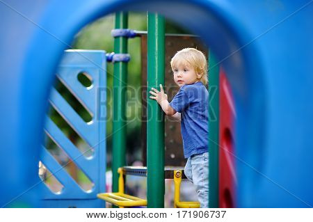 Cute Toddler Boy Having Fun On Outdoors Playground