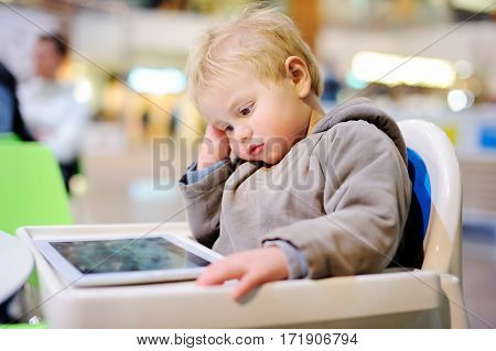 Bored Toddler With A Digital Tablet