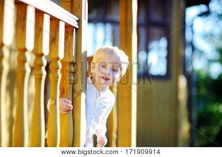 Happy Little Boy Having Fun Outdoors On Sunny Summer Day