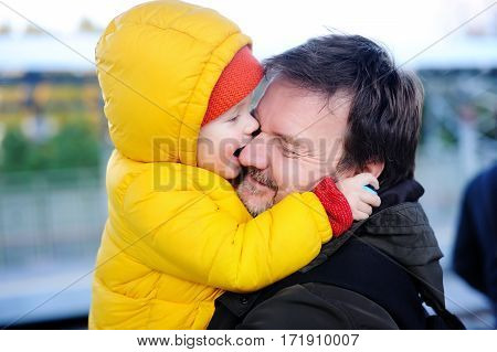 Middle Age Father With His Little Son Having Fun Together Outdoors
