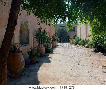 Holy Arkadi Monastery path in the yard , Crete Moni Arkadiou building, old architecture monument
