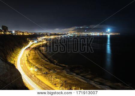 Aerial long exposure of Circuito de Playas from Miraflores Lima Peru at night