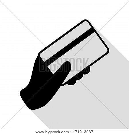 Hand holding a credit card. Black icon with flat style shadow path.