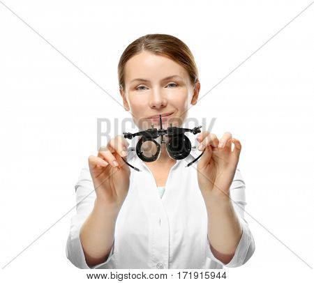 Young woman with trial frame isolated on white