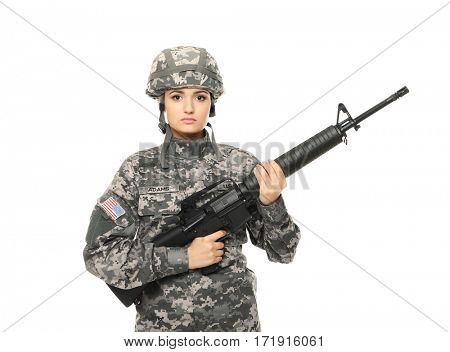 Pretty female soldier with assault riffle on white background